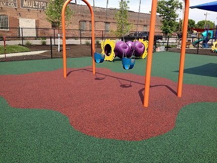 Ecoturf Surfacing Taylormade gallery Kansas City Missouri Weeks Elementary poured in place surfacing graphics and designs omaha nebraska des moines iowa oklahoma city kansas city missouri st. louis chicago illinois synthetic turf bonded rubber mulch colorful fall safety cushion rubber colorful fun children playground