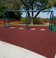Ecoturf Surfacing Taylormade gallery Lawrence Kansas Centennial Park poured in place surfacing graphics and designs omaha nebraska des moines iowa oklahoma city kansas city missouri st. louis chicago illinois synthetic turf bonded rubber mulch colorful fall safety cushion rubber colorful fun children playground